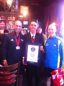 Our brush with celebrities - the world's fastest marathoner dressed as a schoolboy.
