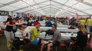 A typical aid station - food and drinks around the edges and runners at tables in the middle.  I think this is Champex.